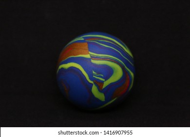 Multi color misket, glass or marble bolls on the black background