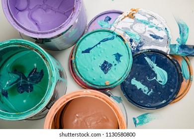 multi color old paint can lids