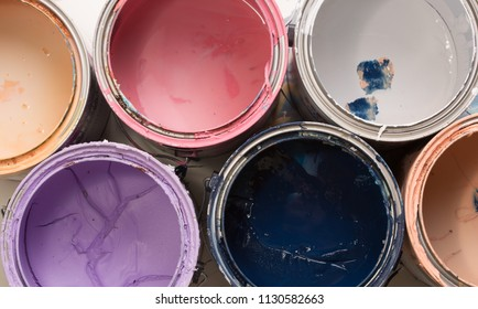 multi color old paint cans on a white background isolated