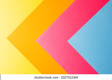 Multi colored abstract paper of pastel colors, with geometric shape, flat lay.
