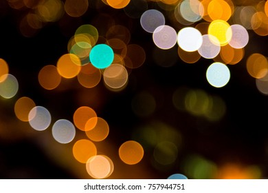 Multi colored Christmas and street Bokeh fairy lights