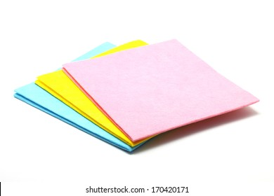 Multi colored cleaning cloths isolated on white background
