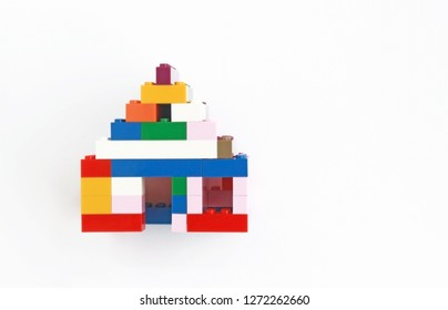 multi colored house built with children building blocks, top view, symbolic picture for building, architecture, design, a home
