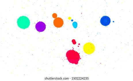 Multi colored ink drops on white paper