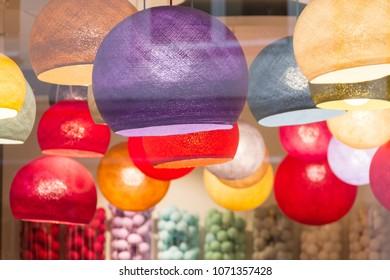 Multi colored lit lampshades in a store, Bruxelles, Belgium