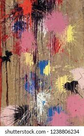Multi colored paint balls splattered on a cement pillar