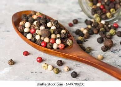 Multi Colored Peppercorns on a Wood Spoon