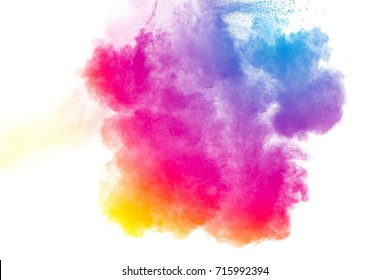 Multi colored powder explosion on white background.