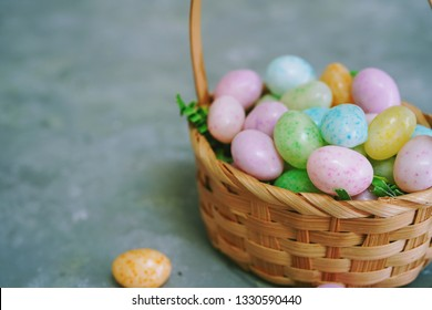 Multi colored speckled jelly beeans eggs/ Easter background, selective focus