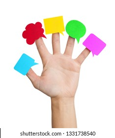 Multi colored speech bubbles on the fingers of the hand isolated on white background