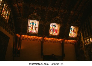 Multi Colored stained-glass Windows on the walls with a pattern