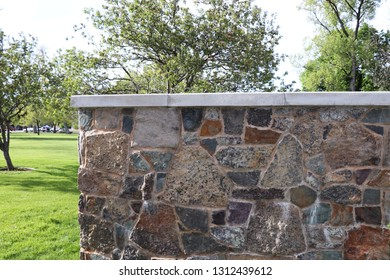 A multi colored textured old stone wall in Logan Utah