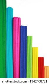 multi colored vertical pattern with crepe paper rolls in front of a white background