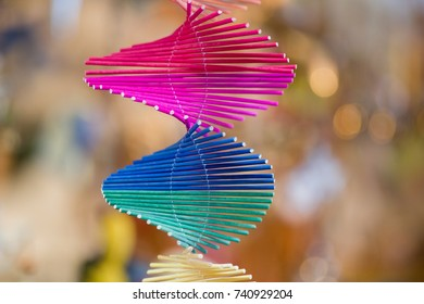 Multi colored and white spirals made from small wooden sticks