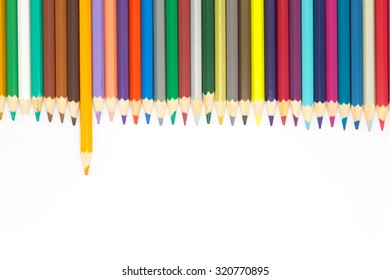 Multi colour wooden pencils on white background