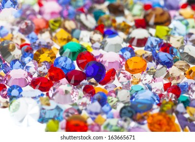 Multi coloured crystals isolated on white with shallow depth of field.