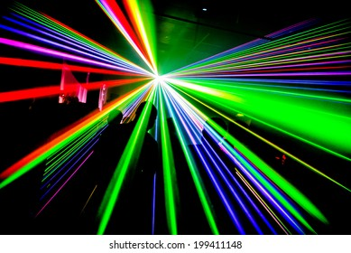 Multi coloured lasers in nightclub party