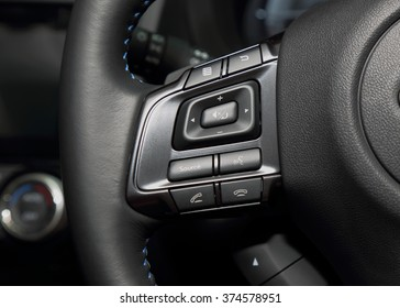Multi control buttons on the steering wheel of the luxury modern car.