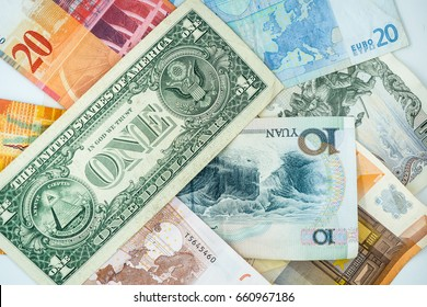 Multi currency note, bank bills and coins indicate world economy during war crisis. Money relate to all circumstances in the world events including stock exchange and fair trade link between countries