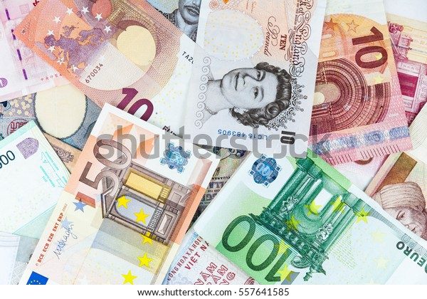 Multi currency note indicating world economy and critical fuel price