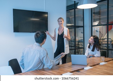 multi ethnic business group and Entrepreneurs conference in modern meeting room with tv conference