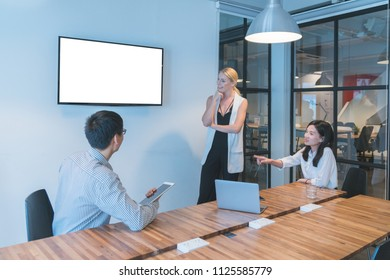 multi ethnic business group and Entrepreneurs discussion  in modern meeting room with tv on white screen copy space