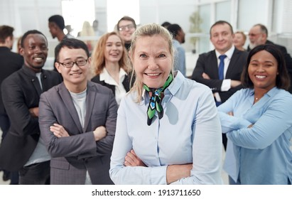 Multi ethnic business people with arms crossed