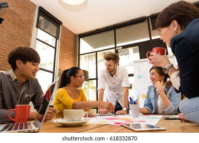 Multi ethnic business person group in casual suit discuss about internal meeting project in modern office. Project and Business concept.