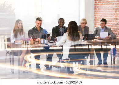 Multi Ethnic Businesspeople Having Meeting And Working In Modern Office