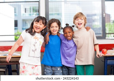 Multi ethnic classroom. Afro american, asian and caucasian primary school kids happy smiling.