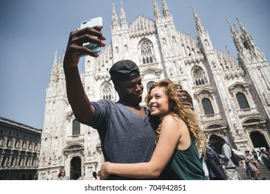 multi ethnic couple doing a selfie in Milan