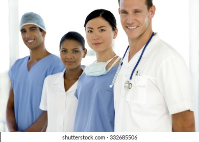 Multi ethnic doctors and nurse standing in a row