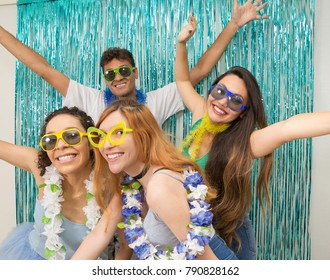 Multi ethnic group of Brazilian friends. Costumed revelers are happy and celebrating the Carnival with much celebration. Young people are with open arms and posing for the photo. Much joy.