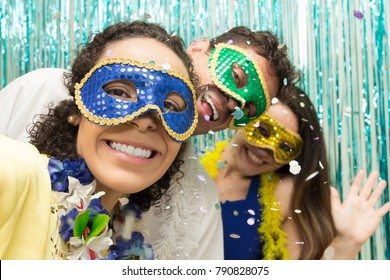 Multi ethnic group of friends is wearing Carnaval masks. Happiness and euphoria. Great party of revelers, all smiling.