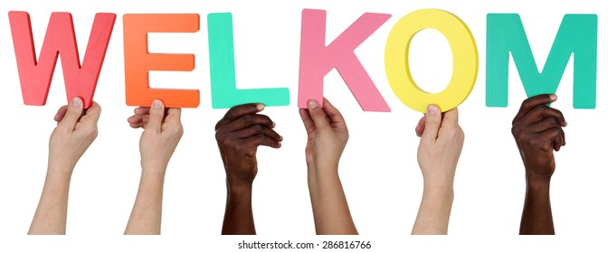 Multi ethnic group of people holding the Dutch word welkom welcome isolated