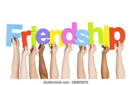 Multi Ethnic People Holding The Word Friendship