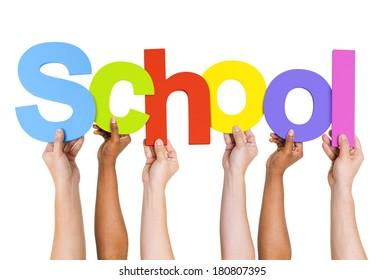 Multi Ethnic People Holding The Word School