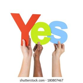 Multi Ethnic People Holding The Word Yes