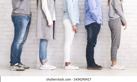 Multi Ethnic People Standing In Row On White Brick Wall Background, Profile