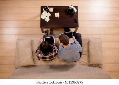 Multi ethnic students couple preparing for exams. top view