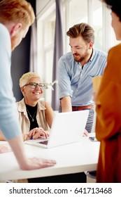 Multi - ethnic team having presentation in modern office