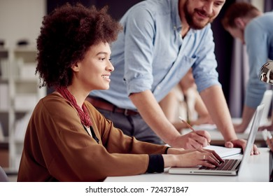 Multi ethnic team working at modern office space