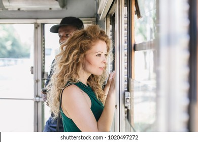 Multi ethnic young couple in love traveling on a tram in summer