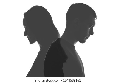 multi exposure black and white silhouettes of portraits men and women on white background. Divorce, relationships concept