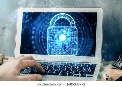 Multi exposure of lock icon with man working on computer on background. Concept of network protection.