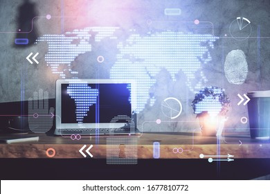 Multi exposure of table with computer and world map hologram. International data network concept.