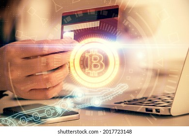 Multi exposure of woman on-line shopping holding a credit card and crypto theme drawing. Blockchain E-commerce concept.