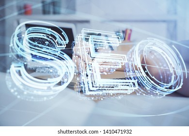 Multi exposure of woman's hands making notes with SEO icon. Concept of Search engine optimization