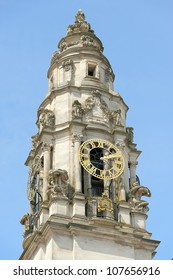 Multi Faced Clock Tower on a Sunny Day with Blue Sky
