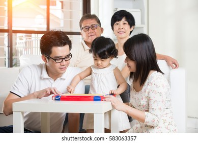 multi generation asian family at home